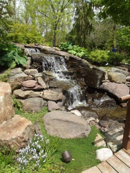 15 Relaxing Backyard Waterfalls Ideas For Your Outdoor 14