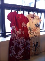 Two Chinese silk dresses, one western, one qí páo.