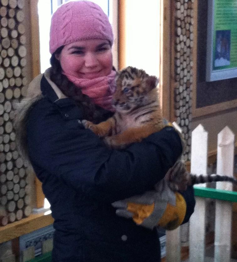 Me, cuddling a baby tiger.