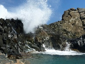Ocean spray cascading into the Natural Pool.