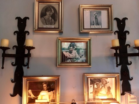 A wall o' the four wives. A somewhat unsettling group of portraits, perhaps.