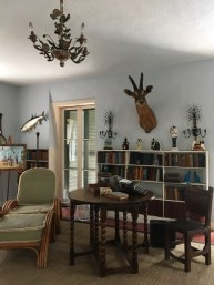 Another shot of Hemingway's writing getaway. Note to nods to his passions: writing, books, fishing, and big game hunting.