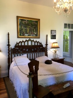 Hemingway's bed, custom-made to accommodate his large size. The headboard is an antique Spanish gate.