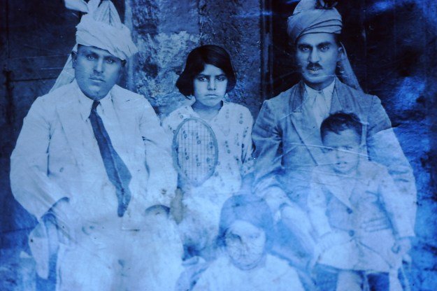 My father, Ghulam Mustafa Quraishi, seated in his father's lap on the far right