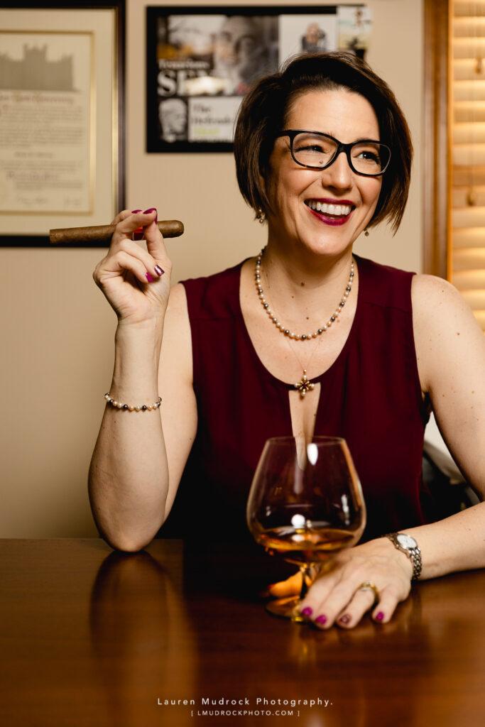 cigar whiskey desk smiling brand photo