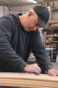 Eric Welkley working in his wood shop on side boards for a Classic GMC truck, March 19, 2017.
