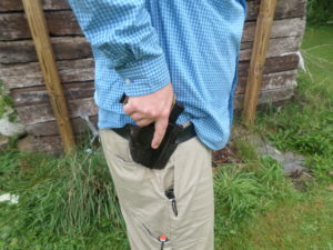 It is extremely important to get a good grip on the pistol at the holster