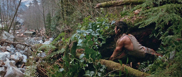 Meanwhile Rambo is living off the land, he hunts and kills a wild boar using his knife attached to the end of a makeshift spear.