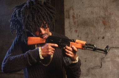 Rapper, Jhybo Detained By SARS For Holding A Rifle In A Picture