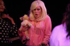 Katherine Tokarz as Reginas Mom with dog