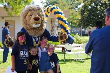 "Samson the Lion poses with new friends made at the annual ""Run for Mercy"" 5K walk/run on September 30 at Vanguard University's Costa Mesa campus as friends, family, alumni and current students came together to raise over $6,000 to support an alumni family whose two-year-old son, Noah, is battling Congenital Heart Disease."