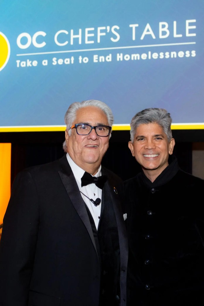 Longtime supporters of Illumination Foundation, alliantgroup's EVP Sonny Grover, right, chatted with IF's CEO Paul Leon, left, after presenting a $5,000 alliantgroup scholarship to a formerly homeless student who wants to become a teacher.