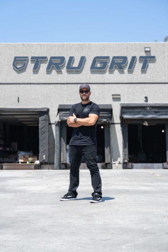 TRU GRIT - Matt Piva in fornt of loading docs-min