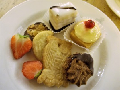 Assorted cakes and fruits