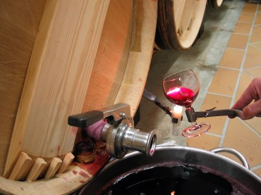 Chateau Haut Brion barrel room filtering the wine with a candle and wine glass photo by Paige Donner copyright 2017 IMG_2633