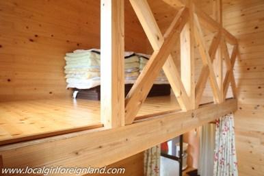 Loft 'bed' inside cottage room. Little Asia guesthouse minamiaso
