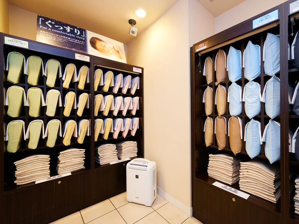 This photo is from http://www.superhotel.co.jp/s_hotels/aomonoyokocho/images/n140812_8EA_3944P.jpg My photo is too dim, I reckon their photo is a way better representative. The 'folded cloth' at the bottom of the shelves are PJs.
