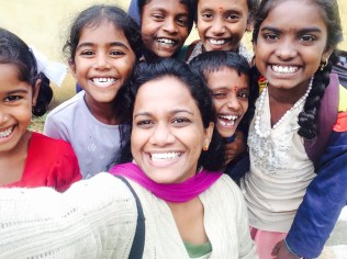 Naveena with school children