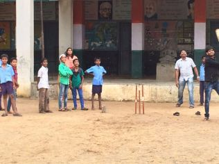 Fun time : Playing cricket with school children