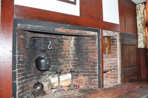 FIREPLACES were necessary to provide both warmth and a means of cooking in the homes of the early inhabitants of town and as such are quite prominent in all of the homes on the historic house tour.  This fireplace in the present-day dining room of the Joseph Tapley House includes a beehive oven at the far right, one of two such ovens in the home.                                 (Maureen Doherty Photo)