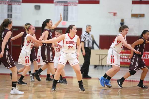 GABBY JOLY, a senior (#12), had four points against Cathedral, while teammates Grace Hurley (#15) recorded three points and Olivia Dziadyk (#23) netted seven points. Wakefield lost the non-league game, 50-35. (Donna Larsson File Photo)