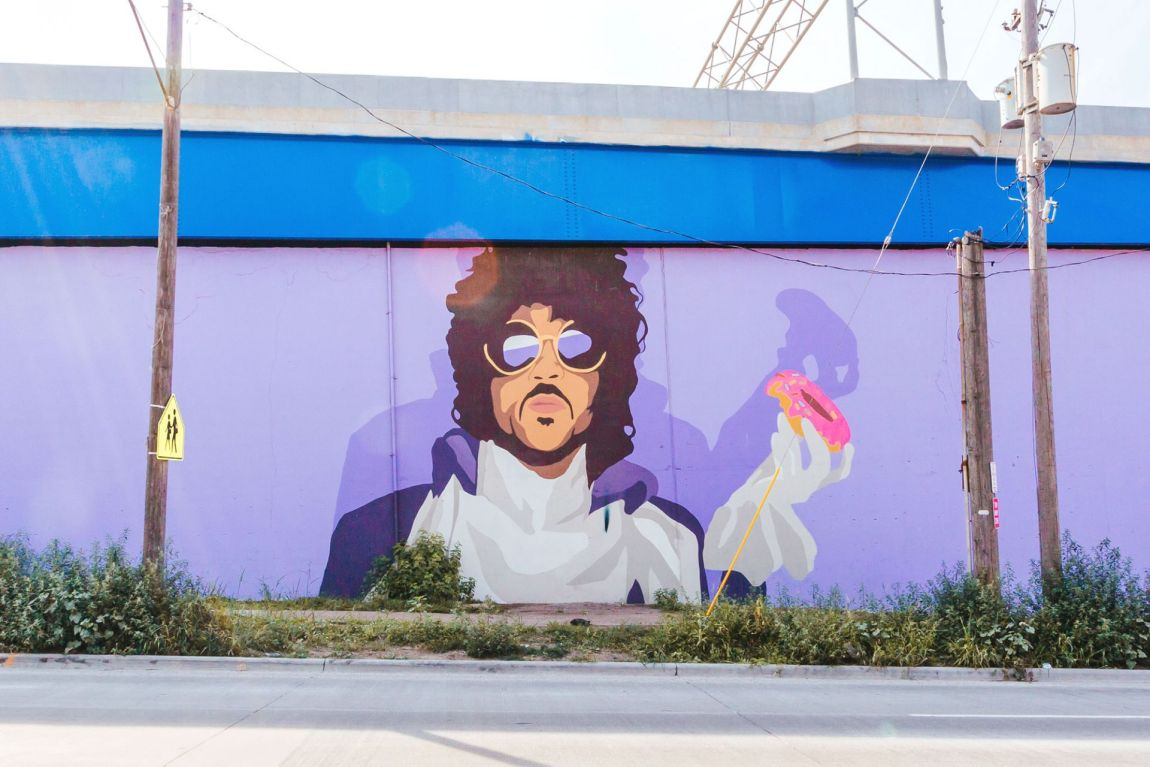 Mural of musician Prince on side of bridge