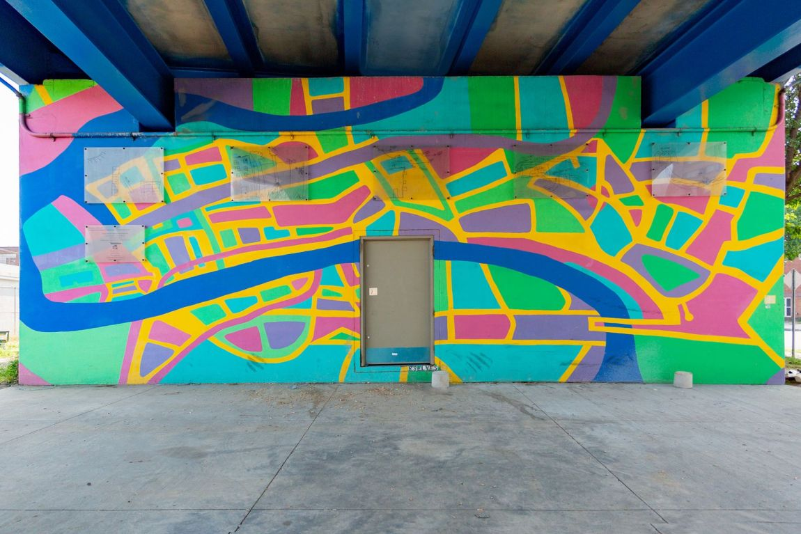 Colorful mural under bridge