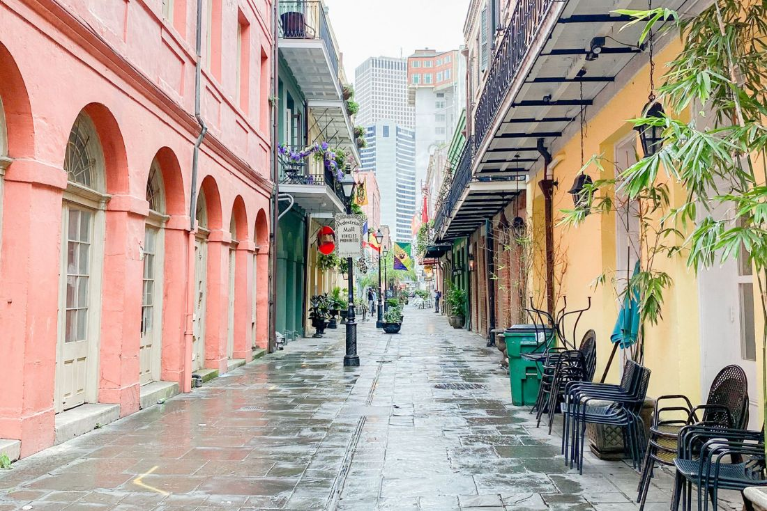 Colorful homes surrounding rain covered courtyard