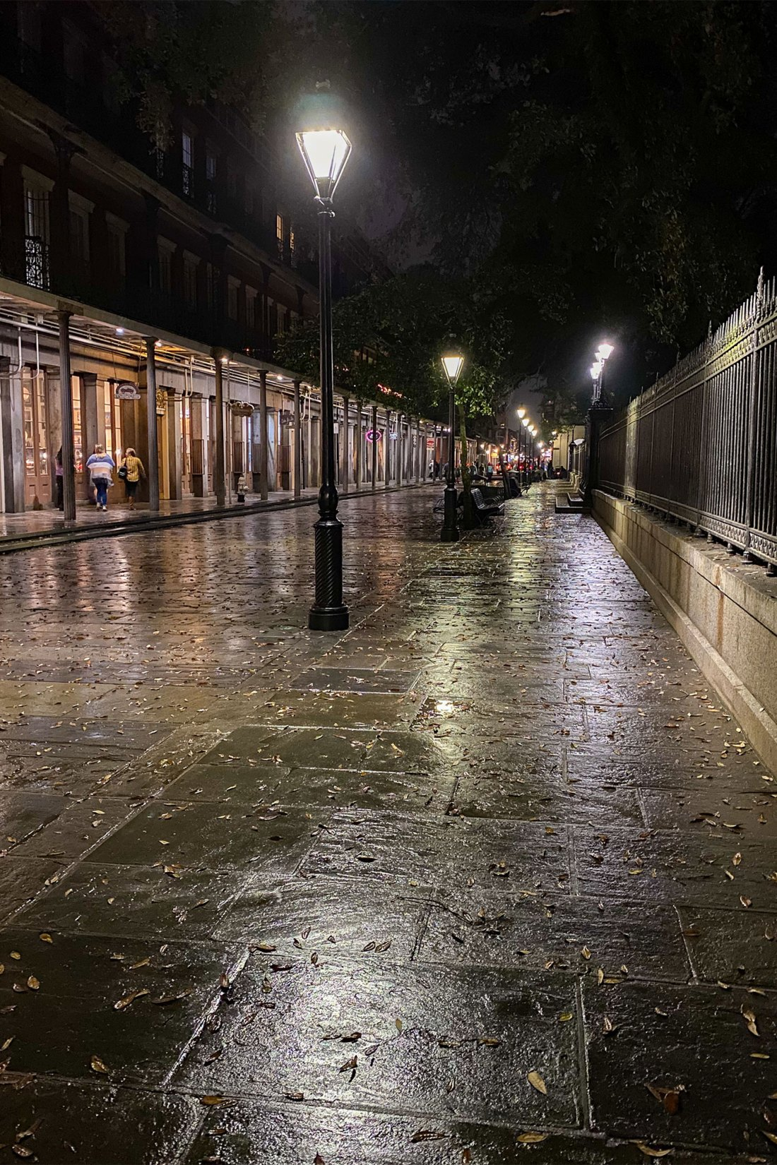 Rain covered alley at night