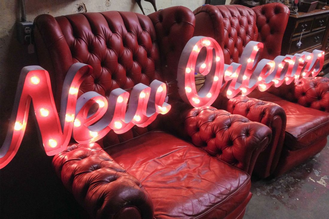 Neon sign set on top of red chairs