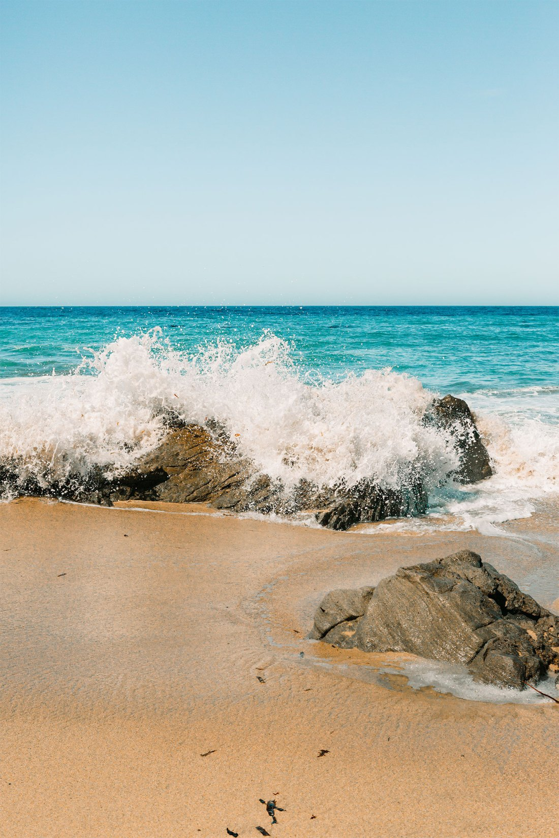 Crashing turquoise waves on a rocky Garrapata State Beach in Big Sur, California | as seen on the Local Love and Wanderlust Blog