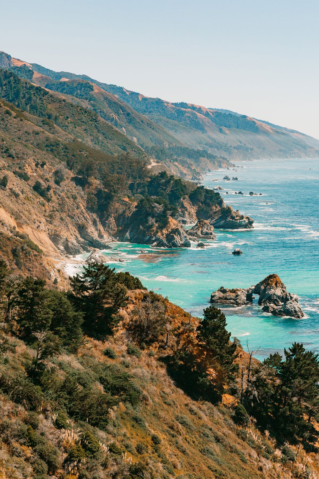 Sparkling turquoise water and ragged coastline of Julia Pfieffer Burns State Park Vista Poiint   as seen on the Local Love and Wanderlust Blog