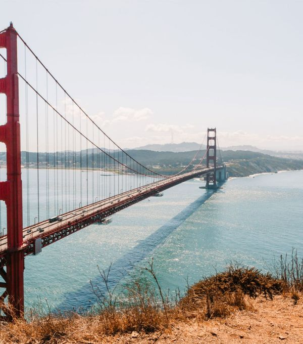 A red Golden Gate Bridge spanning across the Pacific Ocean in San Francisco, California | Local Love and Wanderlust