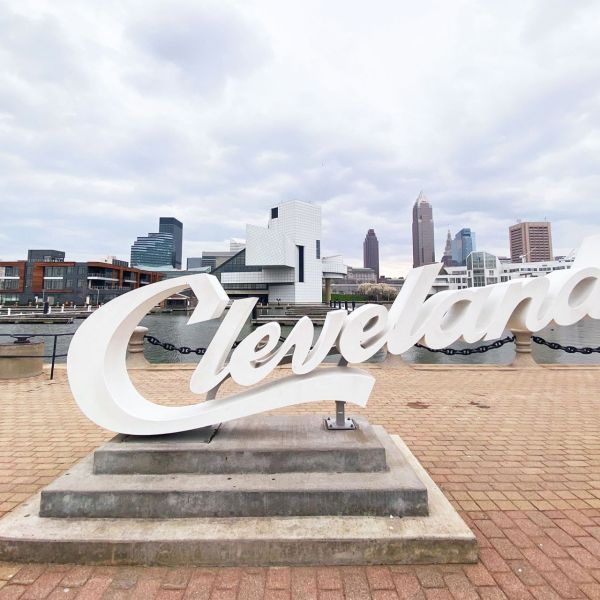 A sign saying Cleveland in front of a downtown scene