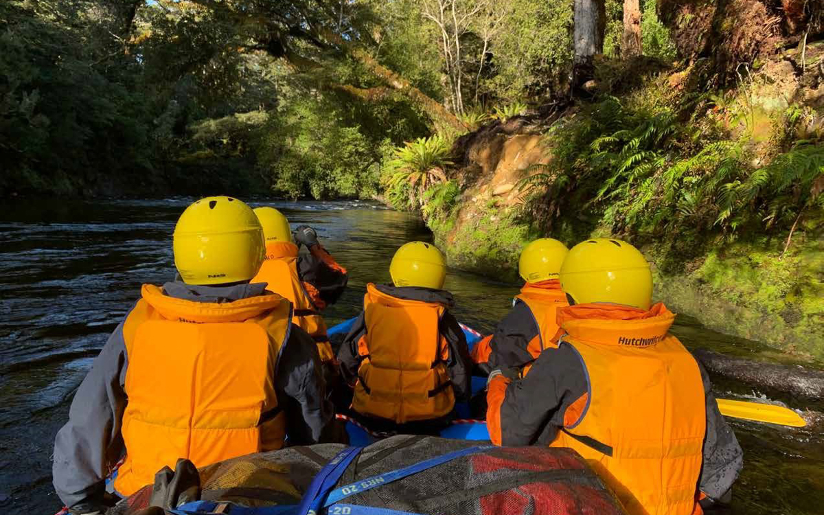 Rafting group navigating remote rivers