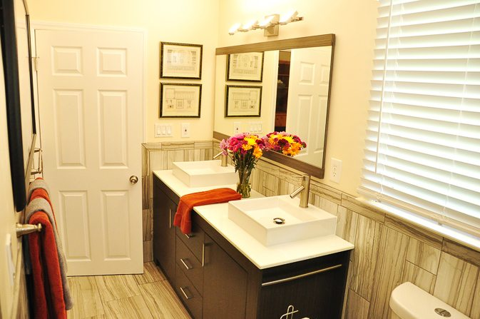 Clean Master Bathroom with Double Vanity Sinks