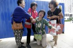 Anger and disbelief from MH370 China relatives over debris - 11