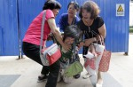 Anger and disbelief from MH370 China relatives over debris - 15