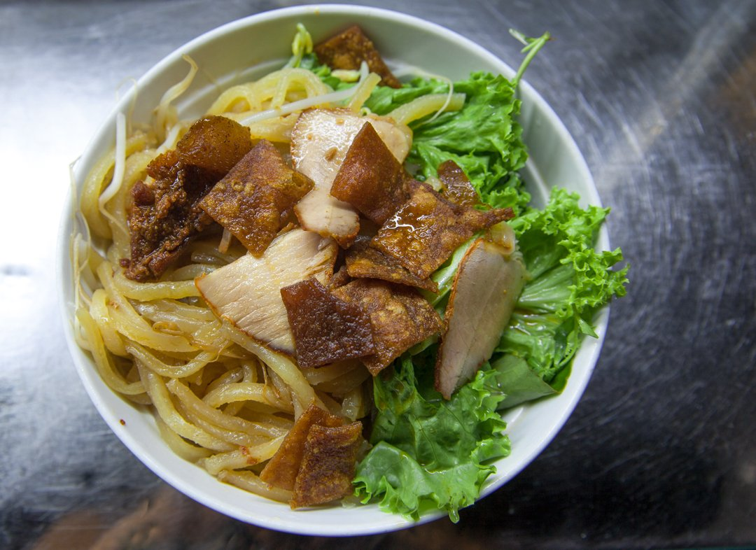 Cao Lau noodles from Hoi An is one of the best vietnamese dishes with cewey yellow noodles, and crispy croutons