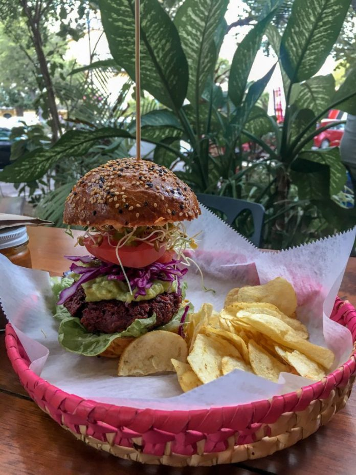 extremely tall veggie burger from Sukra