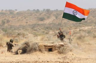 An Indian soldier hoisting the national flag