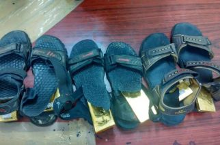 The gold bars were concealed in the passenger's footwear (sandals)