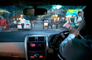 The court noted that excess fare has been charged by the respondents, including Ola and Uber, in violation of the Motor Vehicles Act (Representational Image. Courtesy: AP/Saurabh Das)