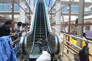 An escalator being installed before at Dadar railway station in Mumbai on Oct.17, 2013. (Photo: Sandeep Mahankaal/IANS)