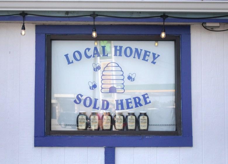 Texas honeybees, local honey sign