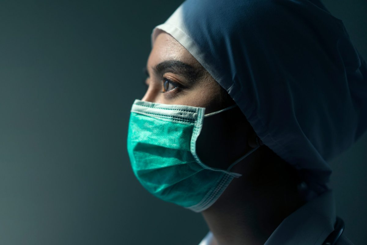 close up of female nurse in a mask