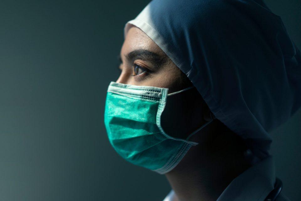close up of female nurse in a mask