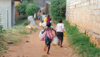 collin county businessman retirement Children carrying water cans in Uganda