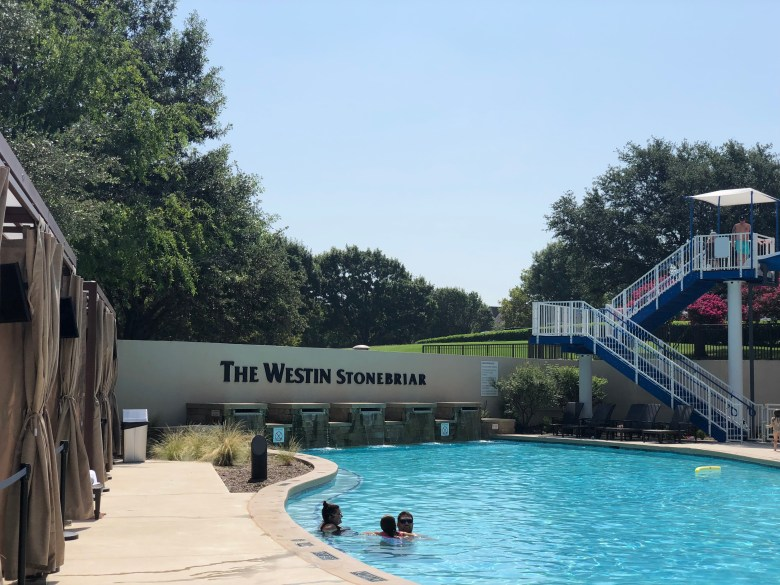the westin stonebriar's pool is surrounded by comfy cabanas and has a large waterslide | photo credit: alex gonzalez