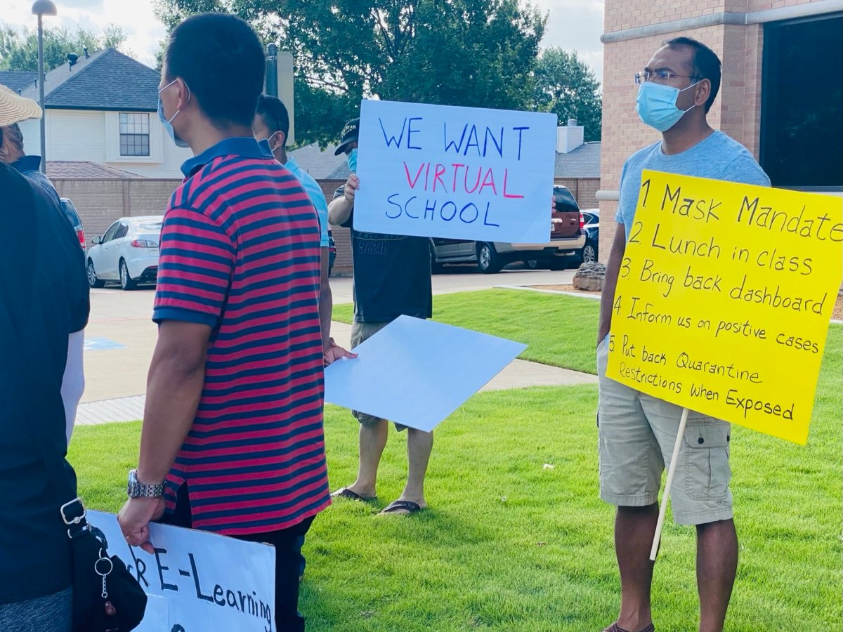 parents protest outside of allen isd | from twitter page @baylee_friday